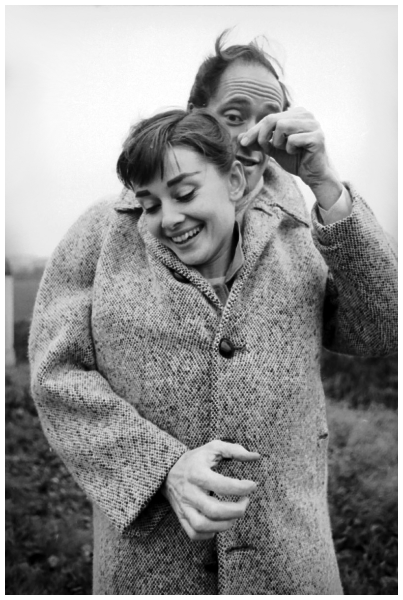 mel-ferrer-with-his-coat-buttoned-up-around-his-wife-actress-audrey-hepburn-1929-1993-on-a-country-road-outside-paris-1956-photo-by-michael-ochs-archivesgetty-images